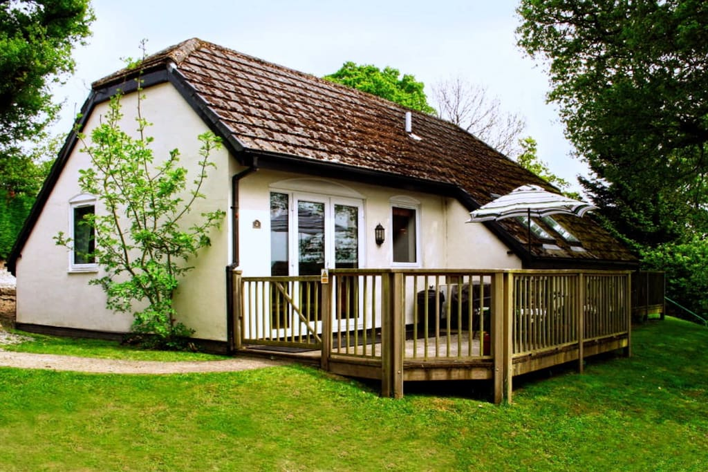 Cottage entrance, decking and outside table and chairs