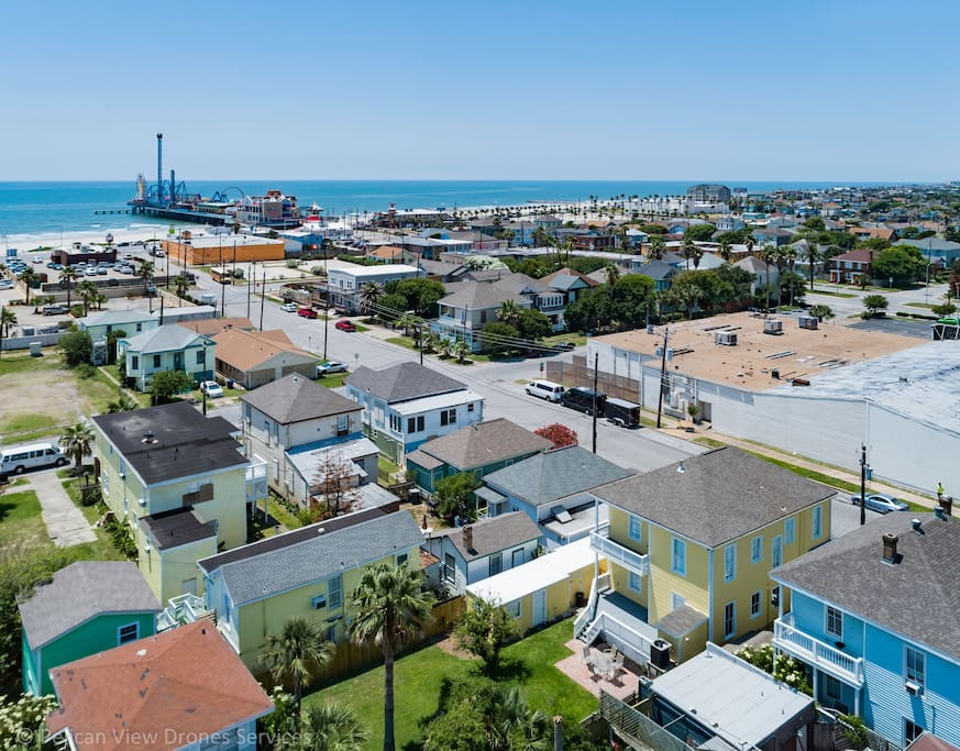 Drone view of the back of The Statesman home to the pleasure pier.