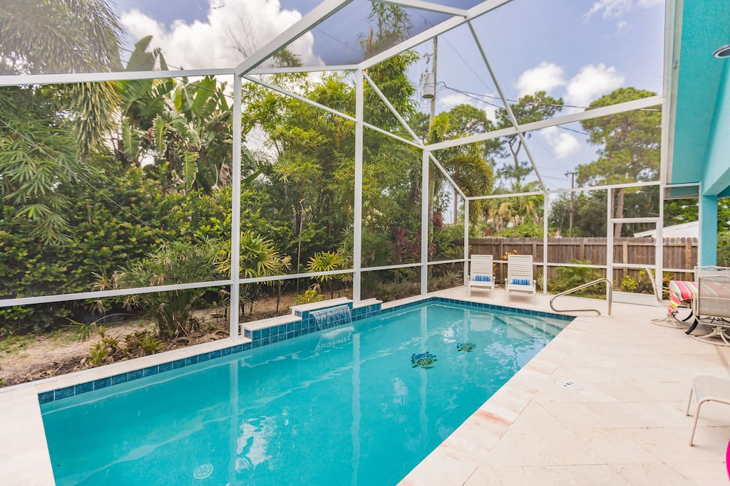 Lanai with heated pool, screen enclosure