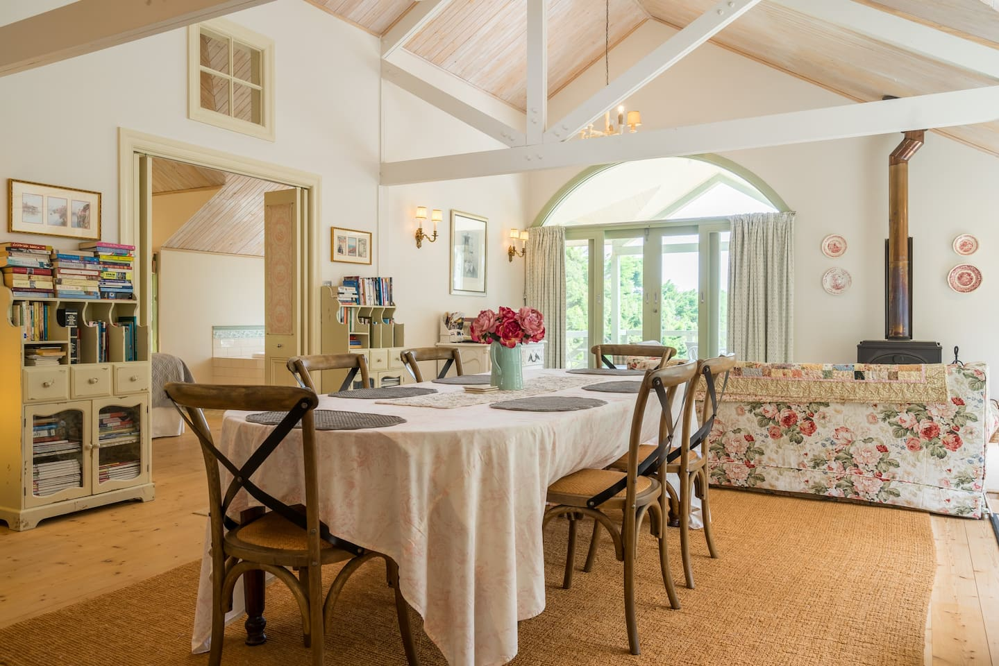 Plenty of room to dine , or read at the Vintage dining table in The Barn .