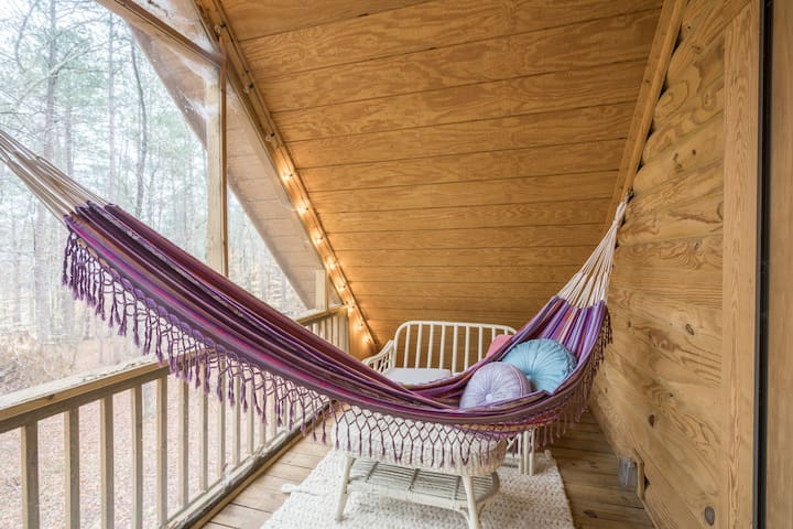 Relax in the hammock on the upstairs balcony, which is fully screened