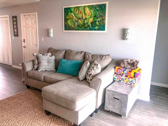 Living room. Sofa has a queen sleeper. TV is smart ready and has cable. WiFi available. Floor pillows. Lots of outlets and USB outlets. Games, puzzles, books and guestbook at the base of the stairs.