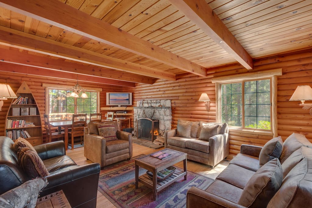 Authentic Log Beams and Framing, Beautiful Knotty Alder Interior Walls, Hardwood Floors in Living Room