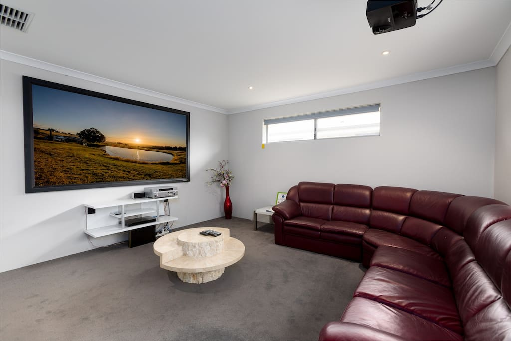 Large projector screen in Theater room with on-demand movies for your evening entertainment