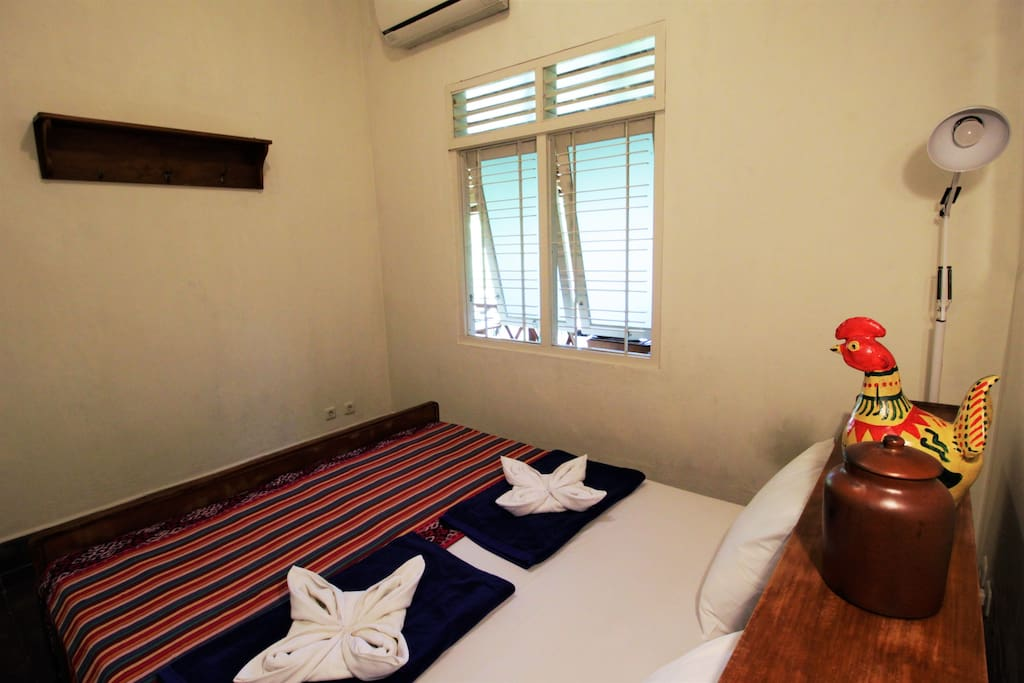Our one and only private room for 2 with a vintage Javanese style bed.
