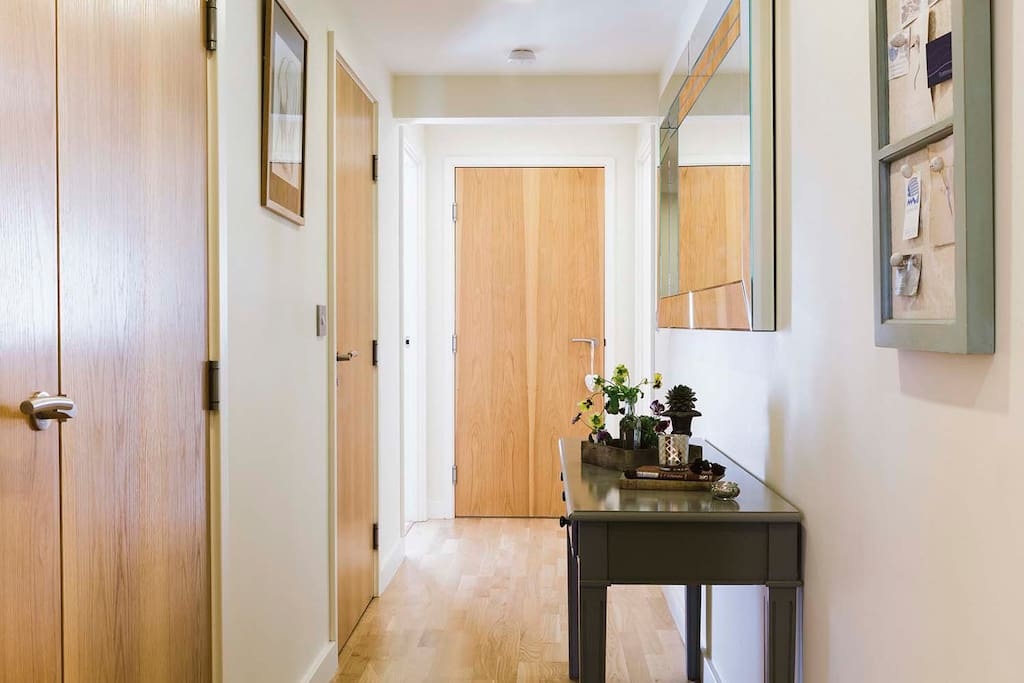 Light and airy hallway leading to all properties
