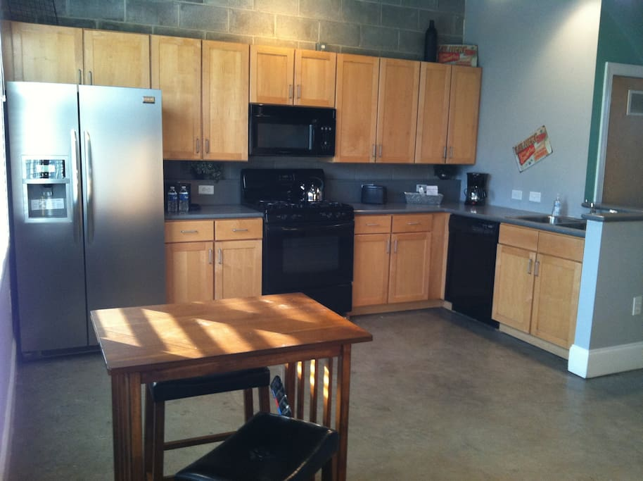 This open kitchen is great for cooking AND it comes fully stocked including spices and condiments. Gas stove, new appliances including microwave. Just bring some food, we've got the rest.