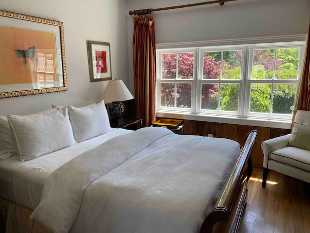 Master bedroom with 10' ceilings, Sunny southern exposure with view of sculpture garden.