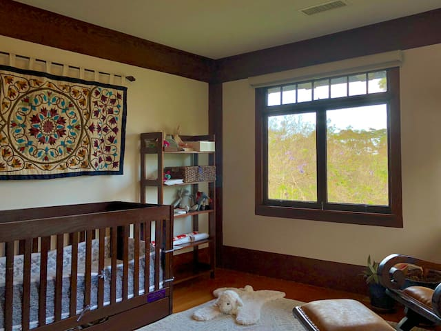 Bedroom 3: Child's room with crib