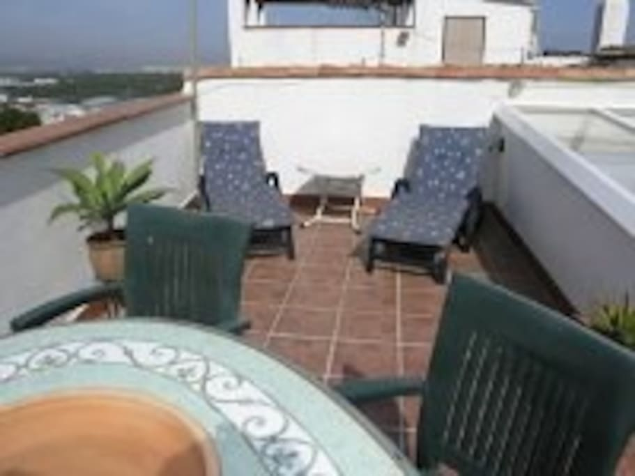 Lovely terrace leading off the lounge with sunbeds and table and seating, a perfect sun trap