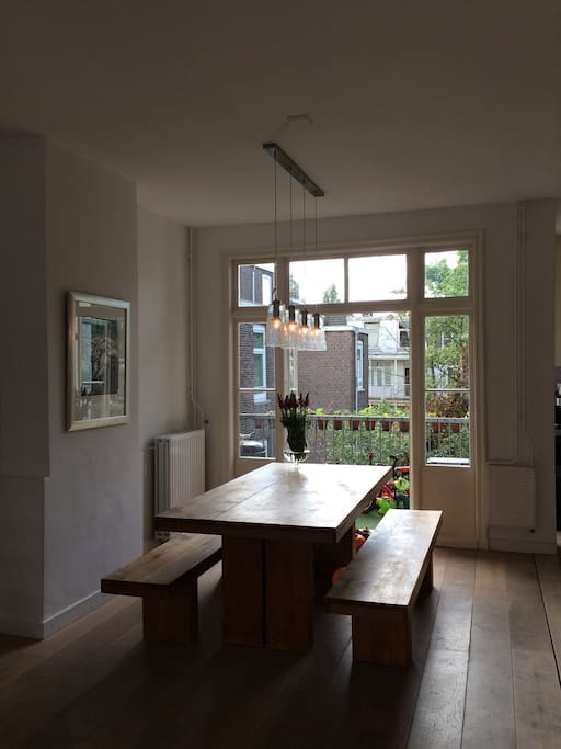 Dining area with double doors opening on balcony