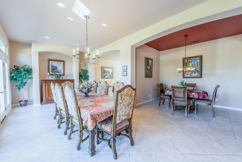Cozy breakfast nook and elegant dining room for eight offer multiple options at mealtime.