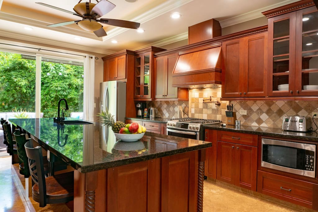 executive kitchen with gas stove.