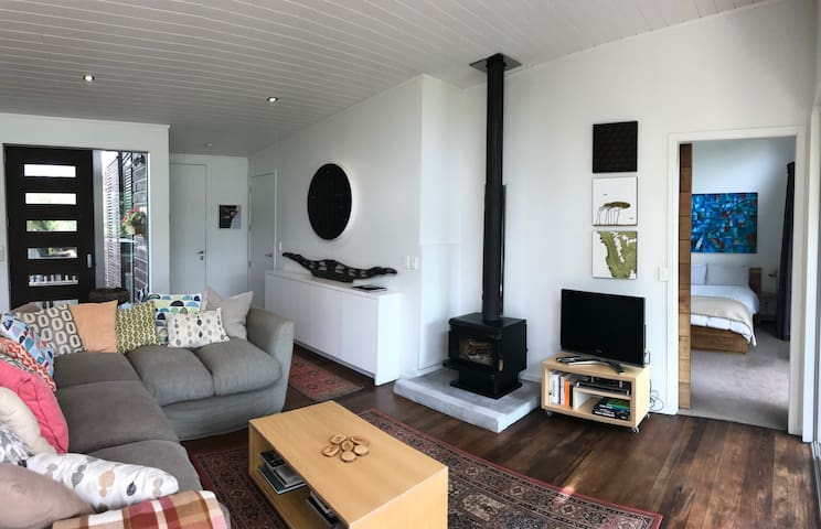 Living area, with a toasty wood fire for cool weather stays