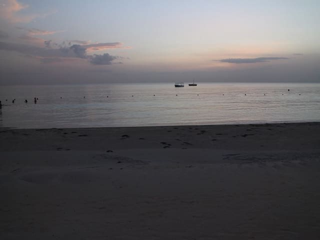 Enjoy a beautiful sunset along 7 Mile Beach.