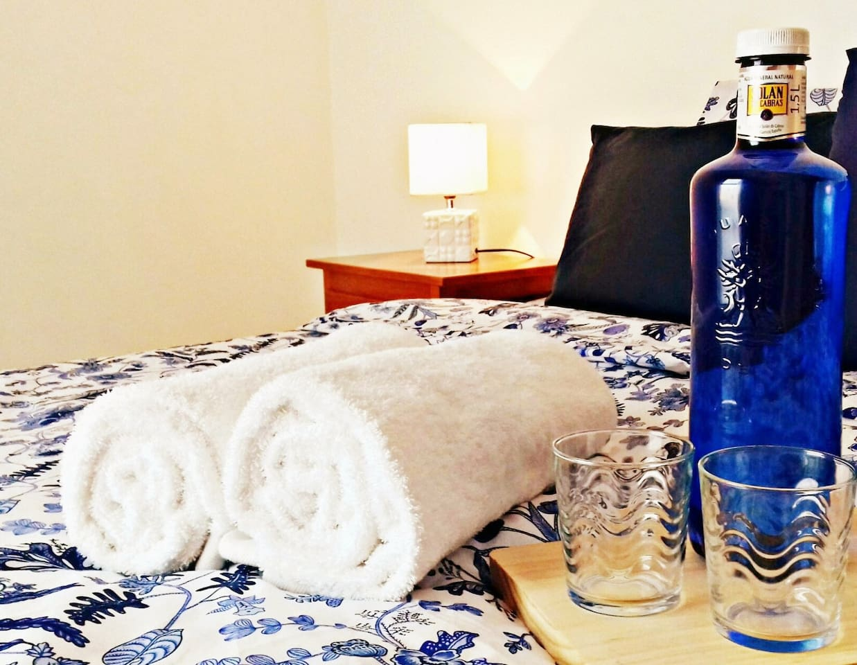 Comfortable cool and bright bedroom with spacious wardrobe, hairdryer, towels, duvet and extra pillows.
