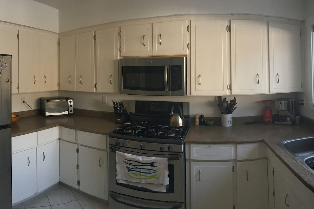 Enjoy cooking some meals in a fully equipped kitchen including a gas range, espresso machine, and dishwasher.