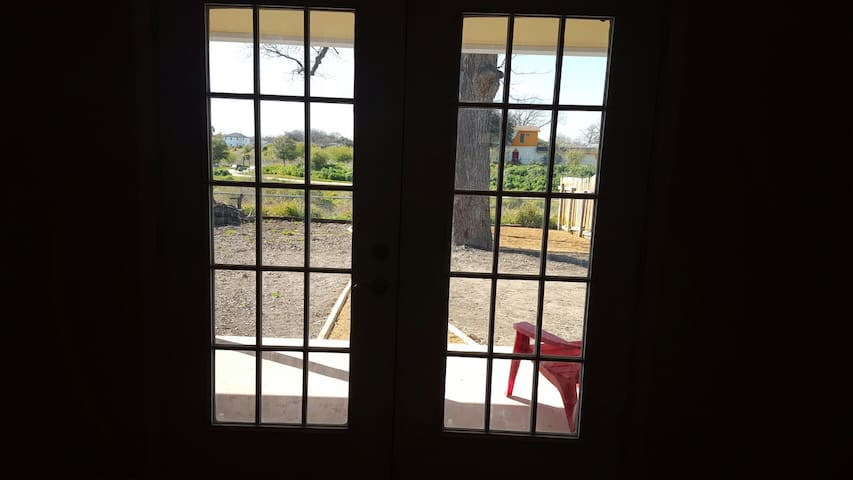 French doors in the living room with view of S.A. River and walking trails.