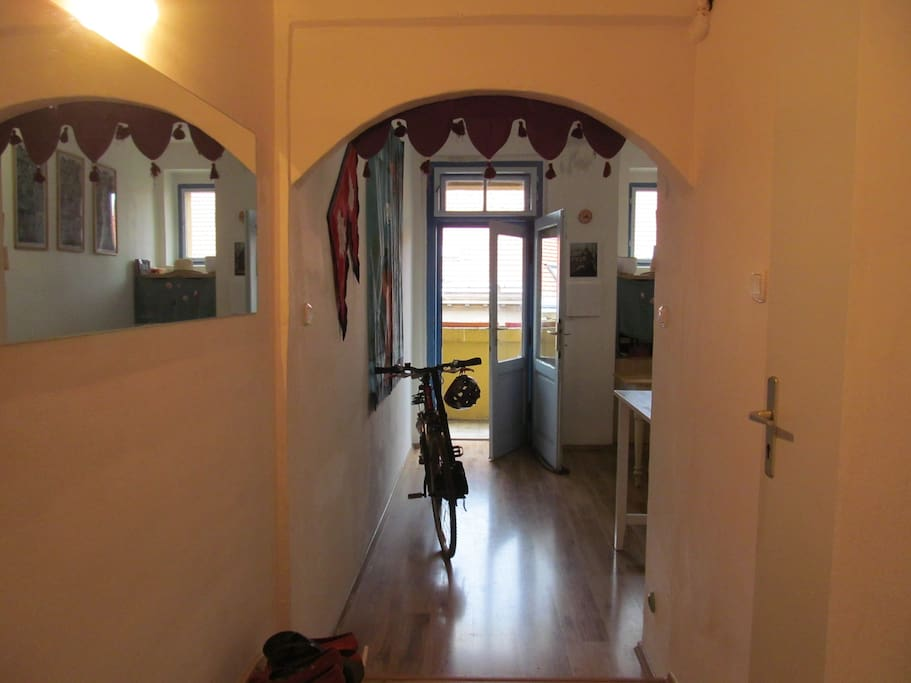 Entrance hall with view to the kitchen and balcony (on the right, door to the bathroom)