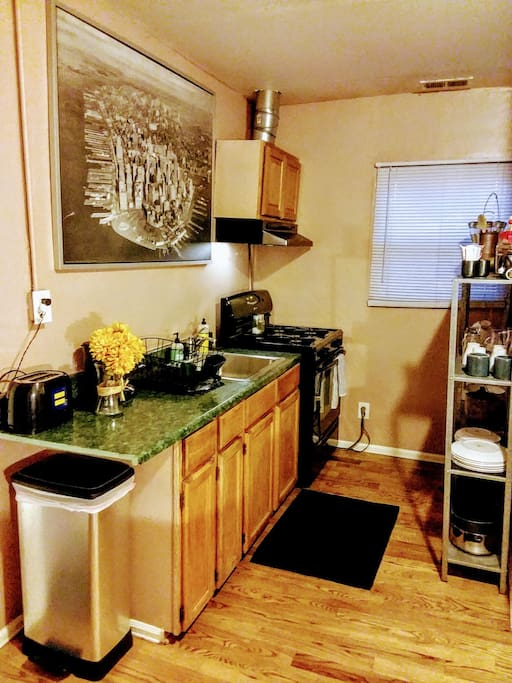 A stocked kitchen, complete with a gas stove, is perfect for a cozy night in, or, a wick snack before heading out on the town!