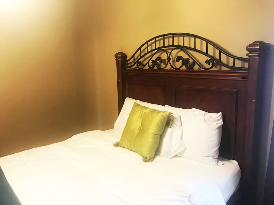 Elegant comfortable queen bed with your own dresser and a small walk-in closet.