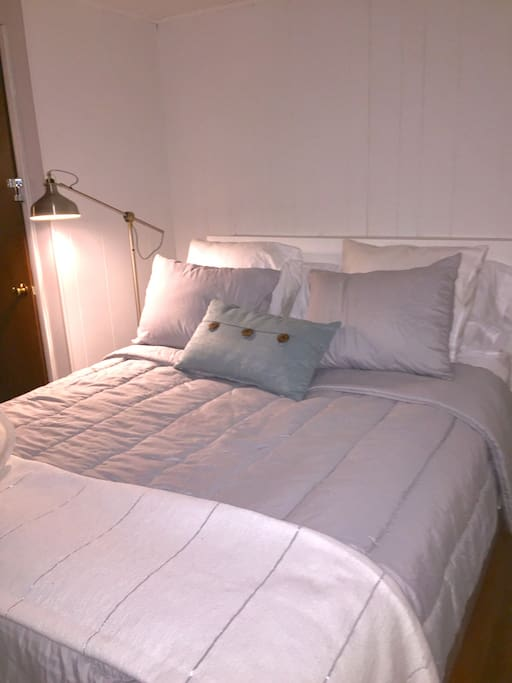 Queen bed downstairs, no pictured half bath also space for air mattress here as well