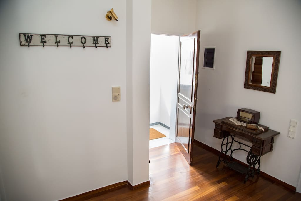 The house has a separate entrance leading to the 1st floor of the duplex apartment.