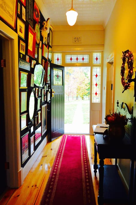 Enter through our eclectic hallway.