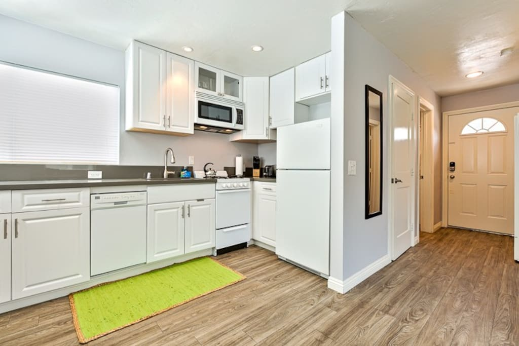 Entrance and fully modern kitchen area with granite counters.