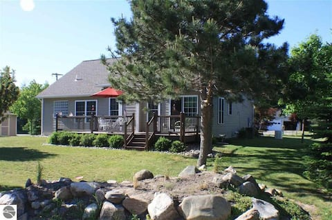 Walk to Empire Beach from this home inside the Village of Empire!