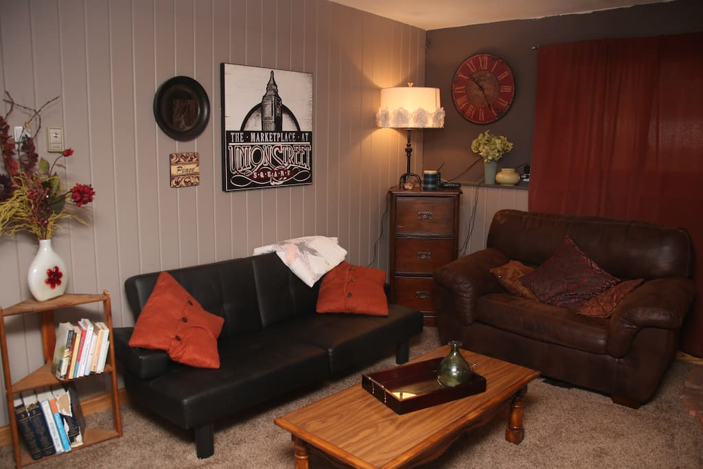 Your own private living room area/ futon folds down to a twin size bed.