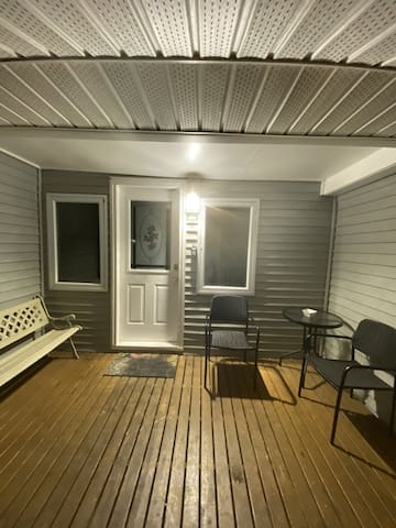 The front entry is well lite up for easy access. You can see there is room for a few to chill on one of the two private decks you have.  The awning is a great asset. There are also two more chairs that you cannot see in this picture.