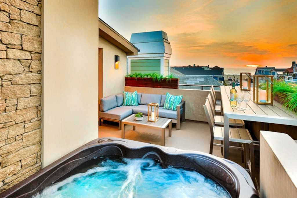 Modern Luxury 1 Deck with jacuzzi and comfortable ocean view seating.