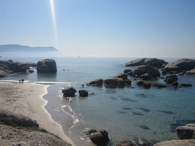 View fromWindmill Beach to Muizenberg Mountain. This beautiful little beach is great for safe swimming, sheltered between huge granite boulders and a three minute walk away, across the road.