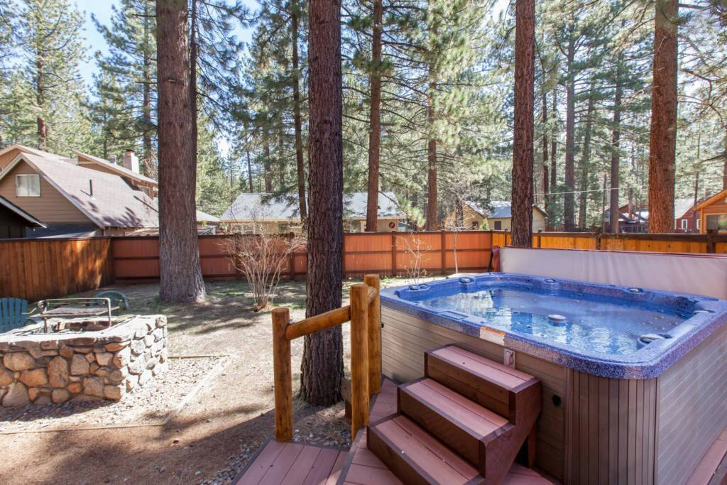 Enjoy the large, completely fenced backyard and hot tub