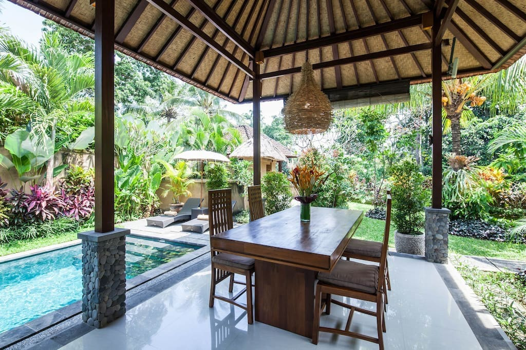 Balinese style and tropical lush garden with open air dinning area.
