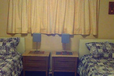 Private quarters includes bedroom, bath & TV room.
