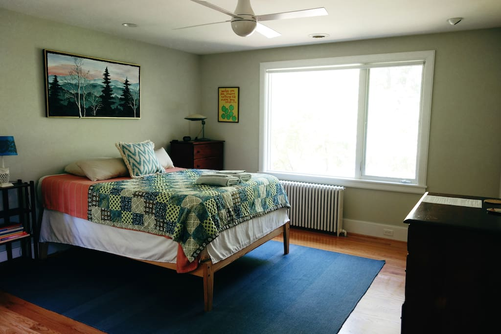 Master bedroom, includes private bathroom and shower.