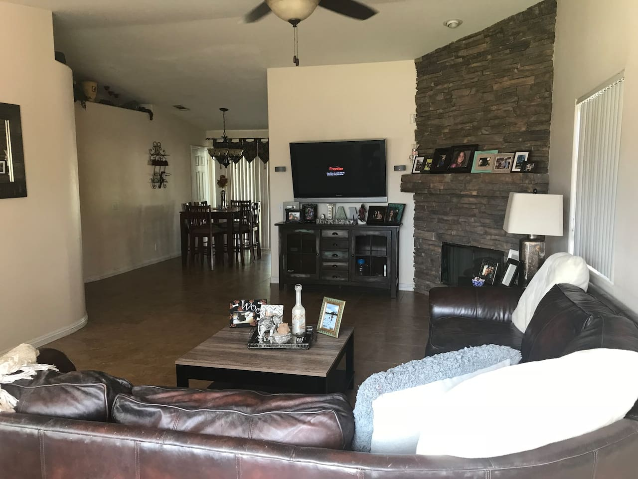 Living room and eating area.  Couch is large enough to sleep two people.  Cable TV, working fireplace.