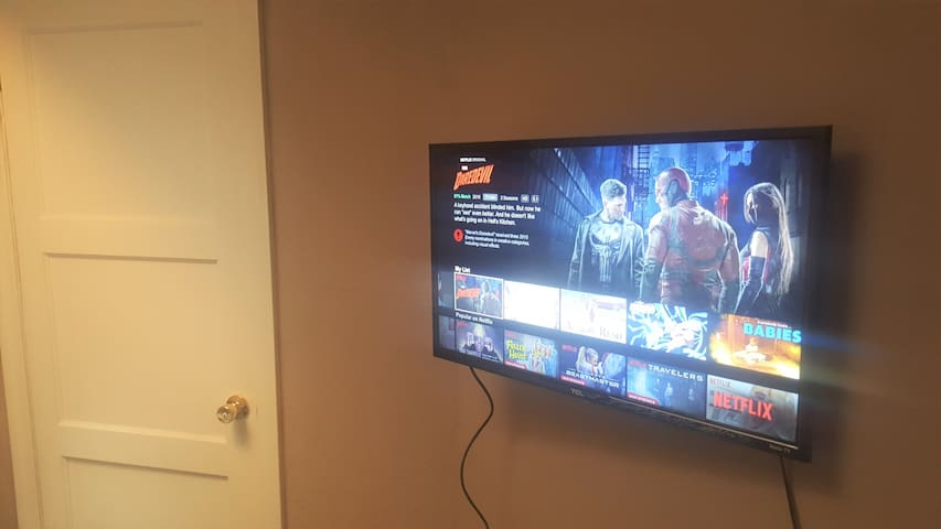 New flat-screen TV in your room with free access to Netflix!