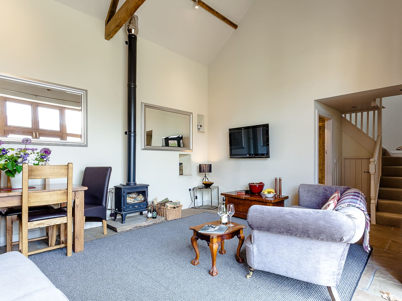 Welcome to The Barn. Snuggle down in the living room with the cosy log burner.