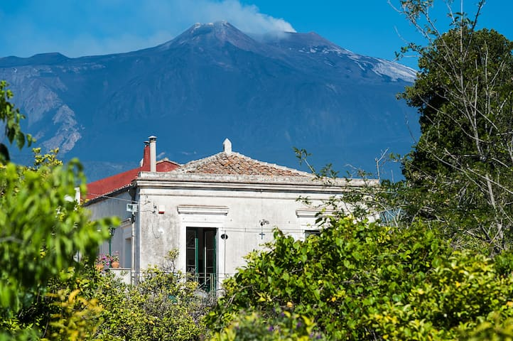 The smoking Etna right behind the villa