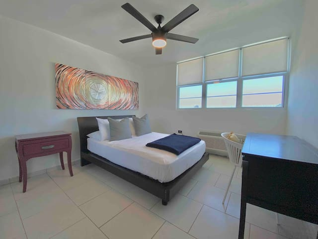 Second bedroom with double size bed. Sleeps 2 guests.  Includes A/C, a comfortable work space area and relaxing views.