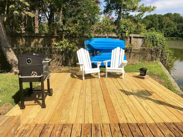 Deck area with charcoal grill and sitting / smoking area.