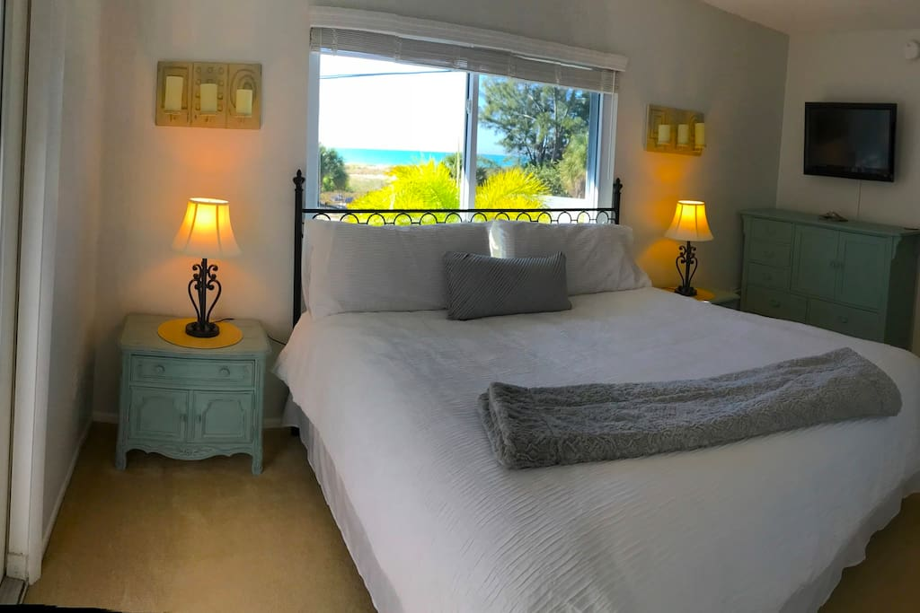 Master Bedroom has king size bed.  Open the windows and fall asleep to the sound of waves on the beach.