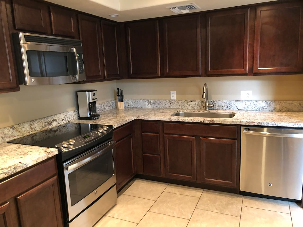 Beautifully updated kitchen with custom cabinets, granite countertops and stainless steel appliances!