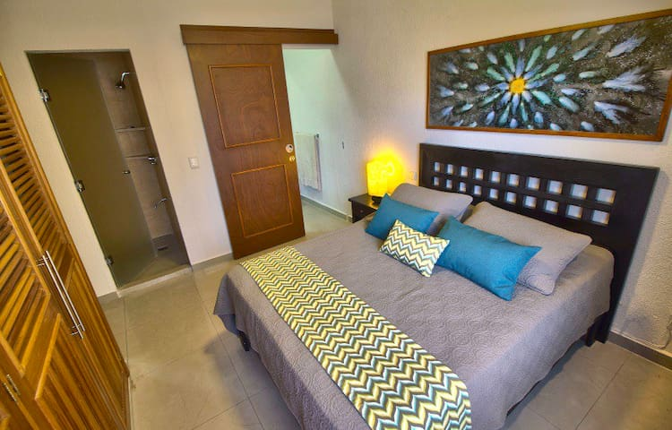 2nd Bedroom with comfy queen size bed . Private full bath