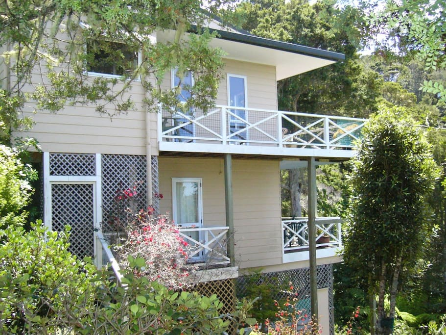 Flat is below main house with its own entrance way and own private deck which is north facing