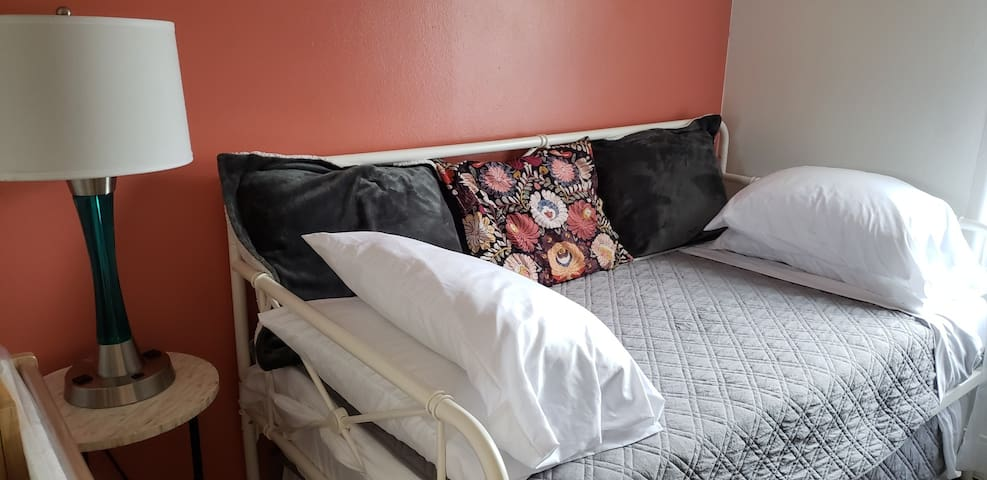 The Red Room/Den/Office-Twin bed with twin trundle.  This room also has a desk with a second TV