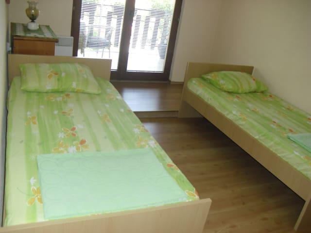 Room with two separate beds and with balcony